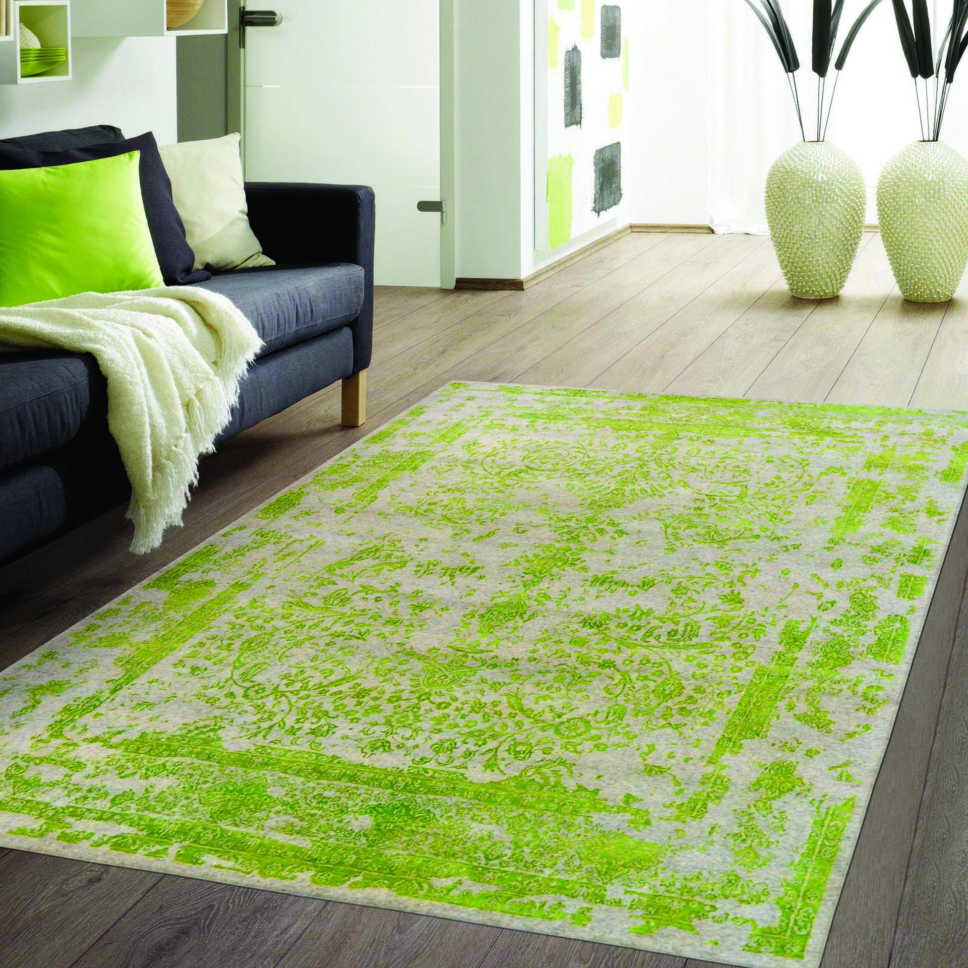שטיח בגוון פסטל ירוק. צמר שטיחים יפים